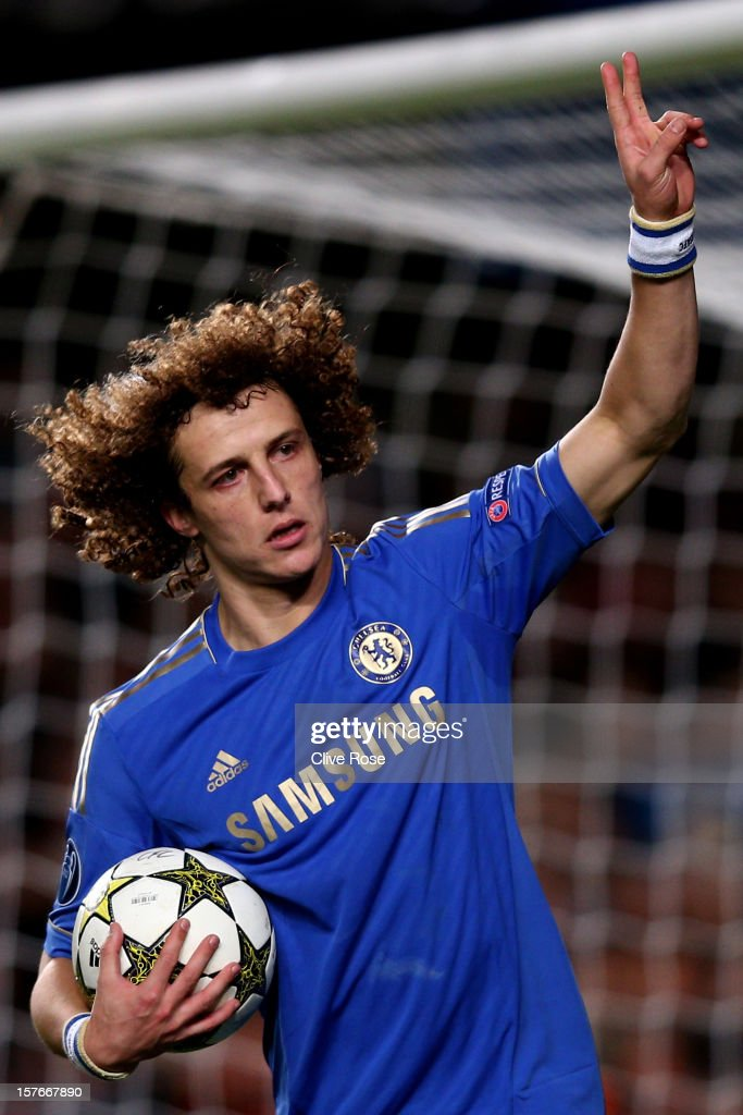 <a gi-track='captionPersonalityLinkClicked' href=/galleries/search?phrase=David+Luiz&family=editorial&specificpeople=4133397 ng-click='$event.stopPropagation()'>David Luiz</a> of Chelsea celebrates after scoring the opening goal from the penalty spot during the UEFA Champions League group E match between Chelsea and FC Nordsjaelland at Stamford Bridge on December 5, 2012 in London, England.