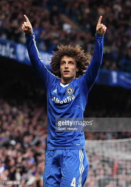 David Luiz of Chelsea celebrates as he scores their first goal during the Barclays Premier League match between Chelsea and Manchester City at...
