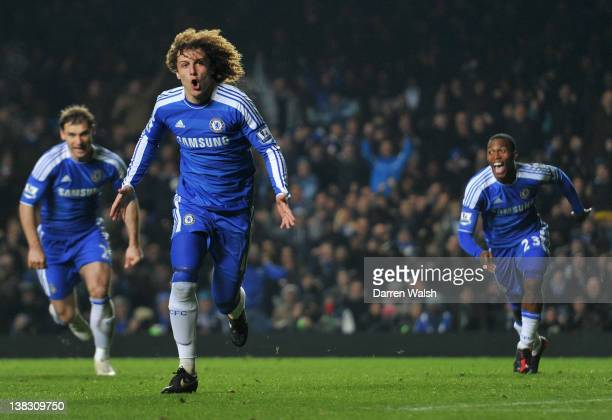 David Luiz of Chelsea celebrates scoring his side's third goal during the Barclays Premier League match between Chelsea and Manchester United at...