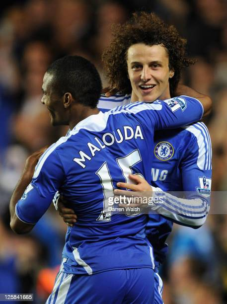 David Luiz of Chelsea celebrates with team mate Florent Malouda after a penalty shootout victory during the Carling Cup Third Round match between...