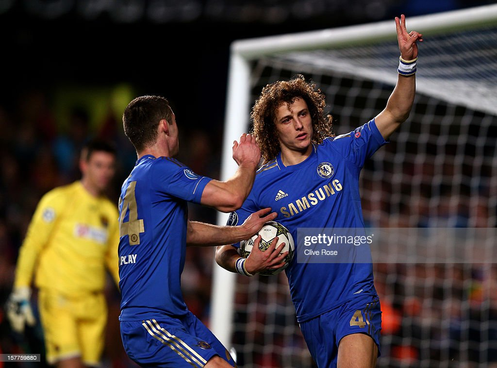 <a gi-track='captionPersonalityLinkClicked' href=/galleries/search?phrase=David+Luiz&family=editorial&specificpeople=4133397 ng-click='$event.stopPropagation()'>David Luiz</a> of Chelsea celebrates with teammate <a gi-track='captionPersonalityLinkClicked' href=/galleries/search?phrase=Gary+Cahill&family=editorial&specificpeople=204341 ng-click='$event.stopPropagation()'>Gary Cahill</a> (L)after scoring the opening goal from the penalty spot during the UEFA Champions League group E match between Chelsea and FC Nordsjaelland at Stamford Bridge on December 5, 2012 in London, England.