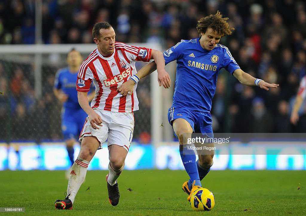 <a gi-track='captionPersonalityLinkClicked' href=/galleries/search?phrase=David+Luiz&family=editorial&specificpeople=4133397 ng-click='$event.stopPropagation()'>David Luiz</a> of Chelsea competes with <a gi-track='captionPersonalityLinkClicked' href=/galleries/search?phrase=Charlie+Adam&family=editorial&specificpeople=3987843 ng-click='$event.stopPropagation()'>Charlie Adam</a> of Stoke City during the Barclays Premier League match between Stoke City and Chelsea at the Britannia Stadium on January 12, 2013, in Stoke-on-Trent, England.