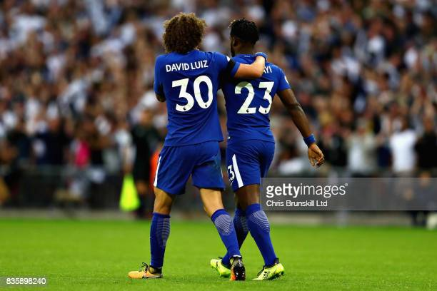 David Luiz of Chelsea consoles teammate Michy Batshuayi after he scored an own goal during the Premier League match between Tottenham Hotspur and...