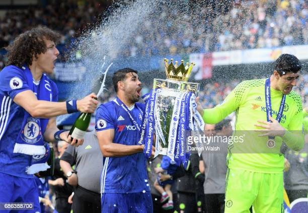 David Luiz of Chelsea Diego Costa of Chelsea and Thibaut Courtois of Chelsea celebrate with the Premier League Trophy after the Premier League match...
