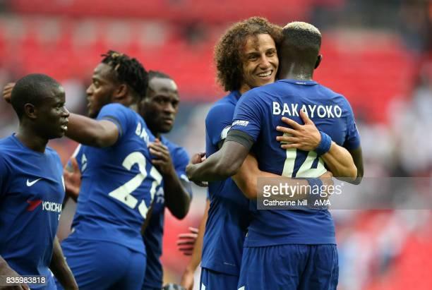 David Luiz of Chelsea hugs Tiemoue Bakayoko of Chelsea during the Premier League match between Tottenham Hotspur and Chelsea at Wembley Stadium on...