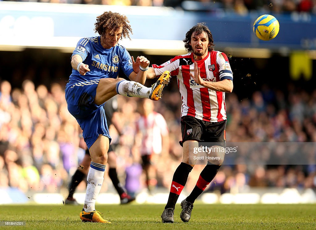 David Luiz of Chelsea (L) in action with Jonathan Douglas of Brentford during the FA Cup Fourth Round Replay between Chelsea and Brentford at Stamford Bridge on February 17, 2013 in London, England.