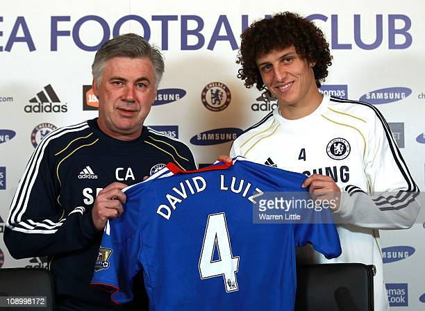 David Luiz of Chelsea is presented his shirt by Chelsea manager Carlo Ancelotti during a press conference at the Cobham training ground on February...