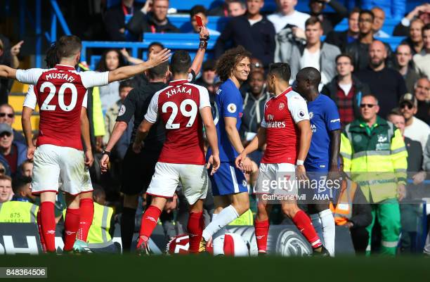 David Luiz of Chelsea is shown a red card and sent off during the Premier League match between Chelsea and Arsenal at Stamford Bridge on September 17...