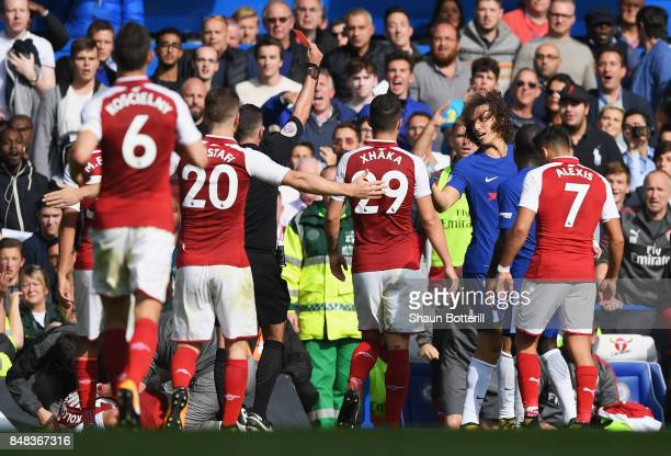 David Luiz of Chelsea is shown a red card by referee Michael Oliver during the Premier League match between Chelsea and Arsenal at Stamford Bridge on...