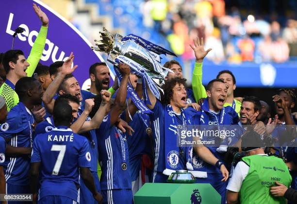 David Luiz of Chelsea lifts the Premier Leauge Trophy after the Premier League match between Chelsea and Sunderland at Stamford Bridge on May 21 2017...