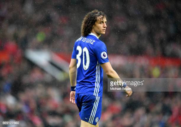 David Luiz of Chelsea looks on during the Premier League match between Manchester United and Chelsea at Old Trafford on April 16 2017 in Manchester...