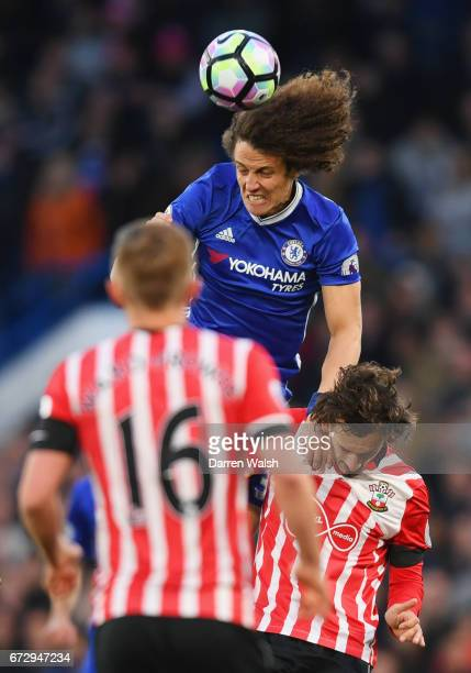 David Luiz of Chelsea outjumps Manolo Gabbiadini of Southampton during the Premier League match between Chelsea and Southampton at Stamford Bridge on...