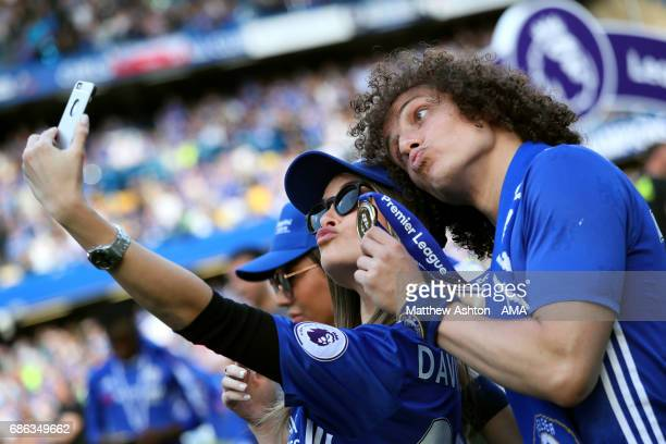 David Luiz of Chelsea poses with his winners medal at the end of the Premier League match between Chelsea and Sunderland at Stamford Bridge on May 21...