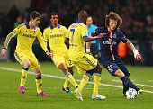 David Luiz of Paris SaintGermain is watched by Oscar Juan Cuadrado and Ramires of Chelsea during the UEFA Champions League Round of 16 match between...
