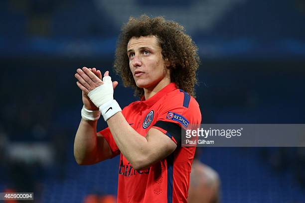 David Luiz of PSG applauds the fans following his teams victory following extra time during the UEFA Champions League Round of 16 second leg match...