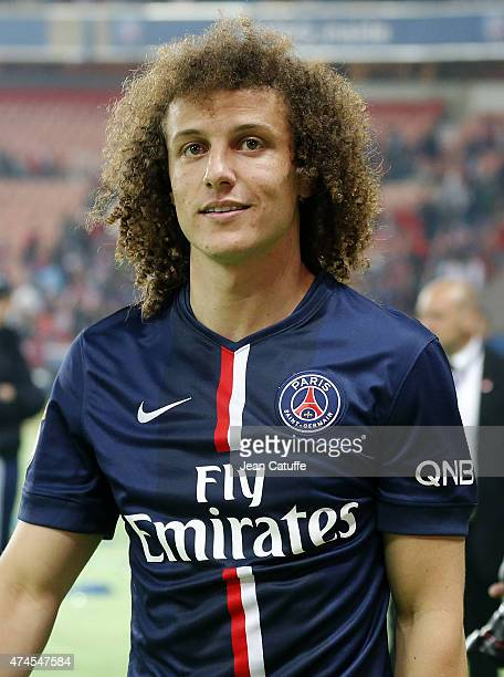 David Luiz of PSG celebrates winning the French Ligue 1 championship 20142015 during the trophy ceremony following the match between Paris...