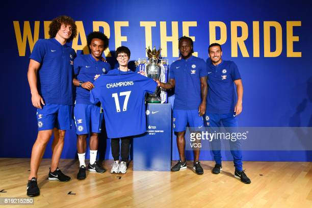 David Luiz Willian a fan Victor Moses and Pedro of Chelsea FC pose with the Premier League trophy during an activity ahead of the PreSeason Friendly...