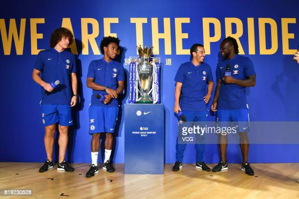 David Luiz Willian Pedro and Victor Moses of Chelsea FC pose with the Premier League trophy during an activity ahead of the PreSeason Friendly match...