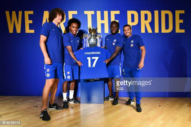 David Luiz Willian Victor Moses and Pedro of Chelsea FC pose with the Premier League trophy during an activity ahead of the PreSeason Friendly match...