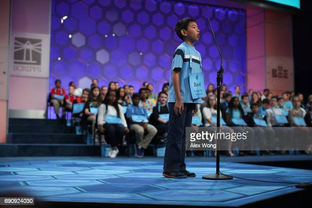 David Lye of Olathe Kansas spells his word during round two of 2017 Scripps National Spelling Bee at Gaylord National Resort Convention Center May 31...
