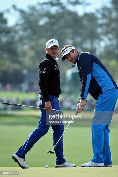 David Lynn of England and Jamie Donaldson of Wales look over a green during a practice round prior to the start of the 2014 Masters Tournament at...