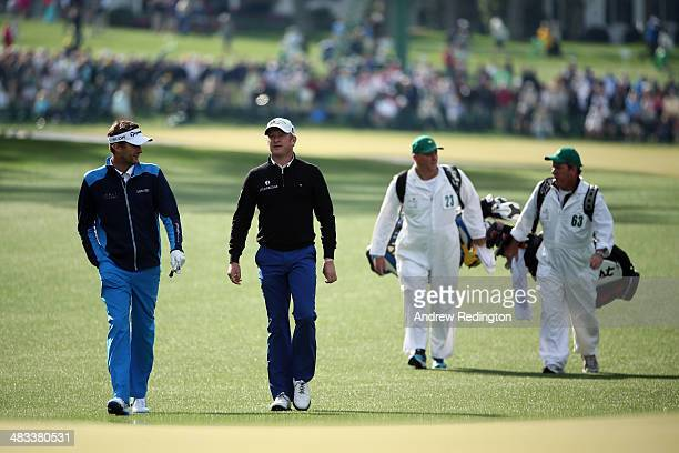 David Lynn of England and Jamie Donaldson of Wales walk to a green during a practice round prior to the start of the 2014 Masters Tournament at...