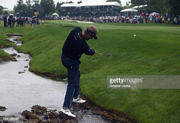 David Lynn of England hits a shot on the 18th hole in a playoff against Derek Ernst during the final round of the Wells Fargo Championship at Quail...