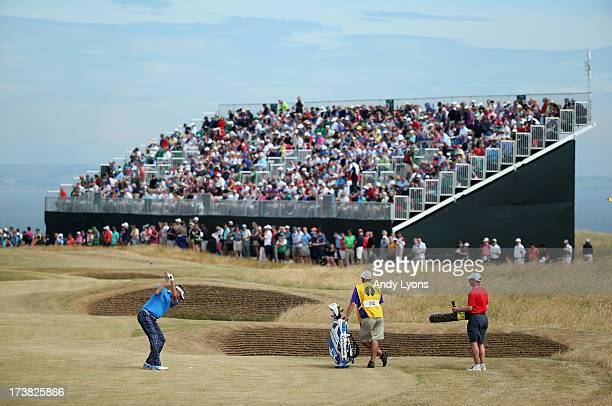 David Lynn of England hits his second shot on the 11th hole during the first round of the 142nd Open Championship at Muirfield on July 18 2013 in...