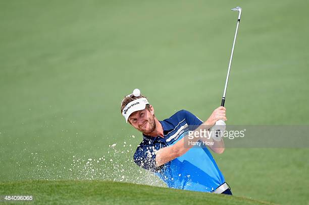 David Lynn of England hits out of a bunker on the second hole during the second round of the 2014 Masters Tournament at Augusta National Golf Club on...