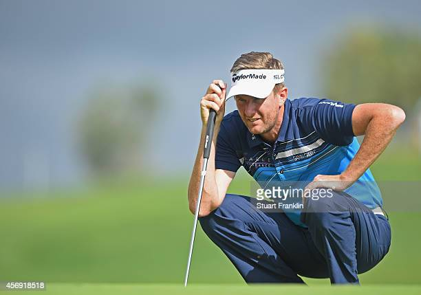 David Lynn of England lines up a putt during the first round of the Portugal Masters at Oceanico Victoria Golf Club on October 9 2014 in Albufeira...
