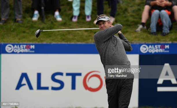 David Lynn of England plays his first shot on the 1st tee during the Alstom Open de France Day Four at Le Golf National on July 6 2014 in Paris France