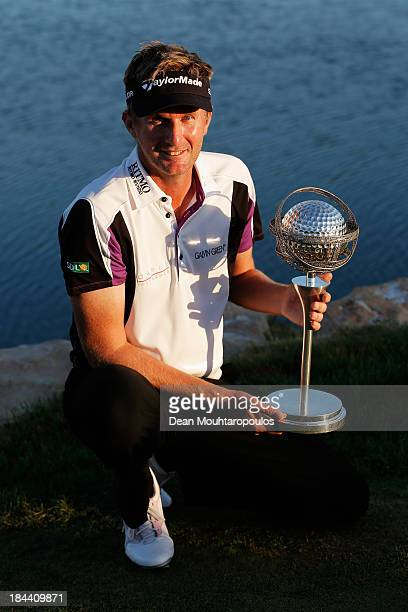 David Lynn of England poses with the trophy after winning the Portugal Masters at Oceanico Victoria Golf Course on October 13 2013 in Faro Portugal