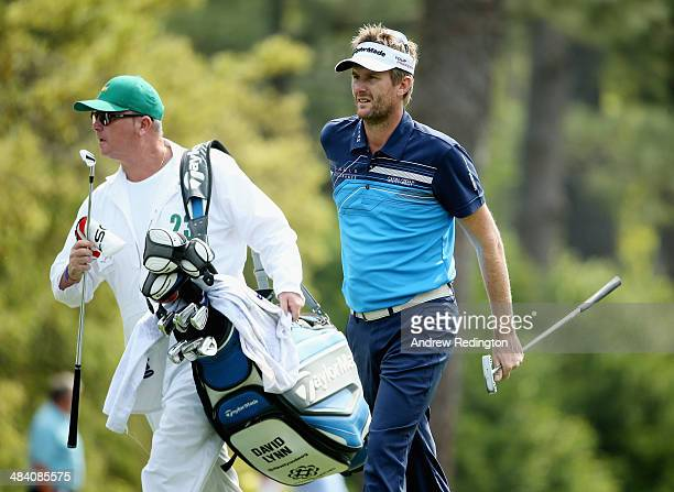 David Lynn of England waits with his caddie Wayne Husselbury on the first hole during the second round of the 2014 Masters Tournament at Augusta...