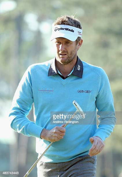 David Lynn of England walks across the first green during the first round of the 2014 Masters Tournament at Augusta National Golf Club on April 10...