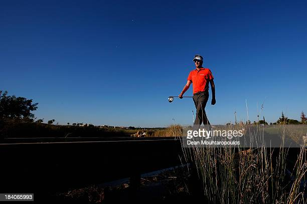 David Lynn of England walks on a bridge after he hits his tee shot on the 17th hole during the second round of the Portugal Masters at Oceanico...