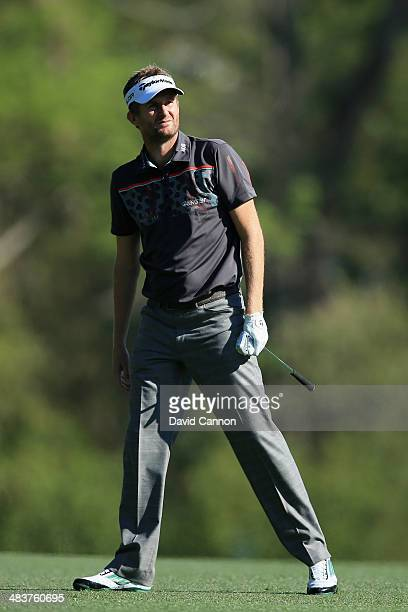 David Lynn of England watches his approach shot on fifth hole during the first round of the 2014 Masters Tournament at Augusta National Golf Club on...