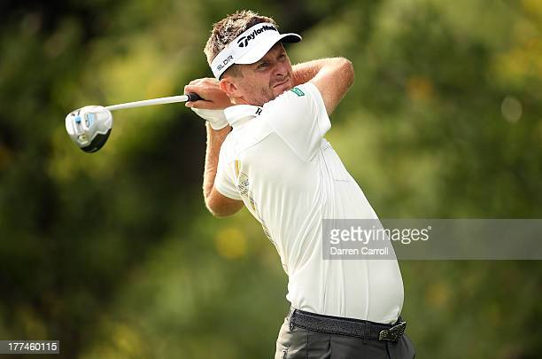 David Lynn of England watches his tee shot on the 16th hole during a continuation of the first round on the second day of The Barclays at Liberty...