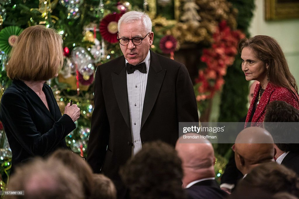 David M. Rubenstein (C), co-founder of The Carlyle Group, and Chairman of the John F. Kennedy Center for the Performing Arts, arrives at the Kennedy Center Honors reception at the White House on December 2, 2012 in Washington, DC. The Kennedy Center Honors recognized seven individuals - Buddy Guy, Dustin Hoffman, David Letterman, Natalia Makarova, John Paul Jones, Jimmy Page, and Robert Plant - for their lifetime contributions to American culture through the performing arts.