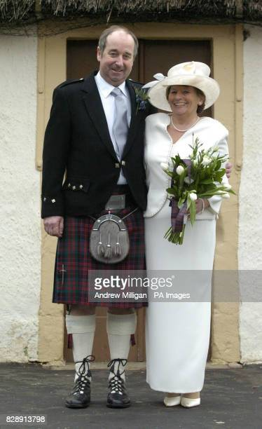 David MacDonald and his bride Sheila McNaughton smile after getting married in the cottage in Alloway Ayrshire where celebrated Scottish poet Robert...