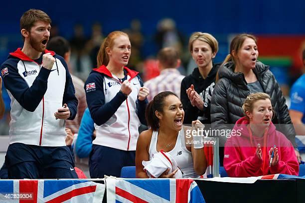 David MacDonaldWatson Heather Watson and Anna Smith of Great Britain celebrate a point for Johanna Konta of Great Britain against Lesia Tsurenko of...