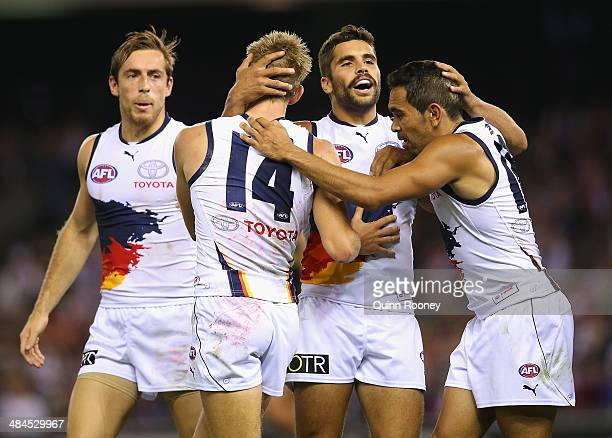 David Mackay Jared Petrenko and Eddie Betts of the Crows celebrates a goal during the round four AFL match between the St Kilda Saints and the...