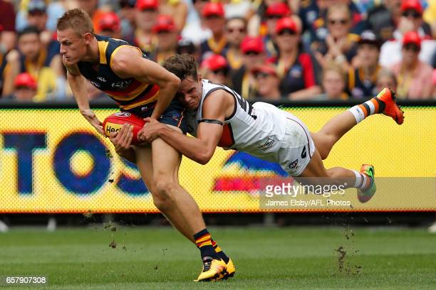 David Mackay of the Crows is tackled by Toby Greene of the Giants during the 2017 AFL round 01 match between the Adelaide Crows and the GWS Giants at...