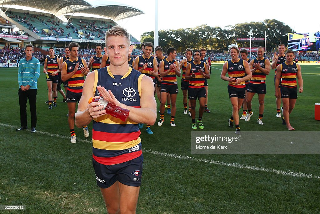 David Mackay of the Crows leads the team from the field after the round six AFL match between the Adelaide Crows and the Fremantle Dockers at Adelaide Oval on April 30, 2016 in Adelaide, Australia.