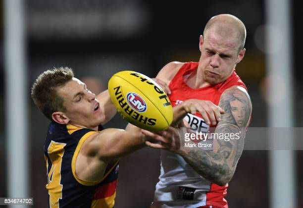 David Mackayof the Crows and Zak Jones of the Swans competes during the round 22 AFL match between the Adelaide Crows and the Sydney Swans at...