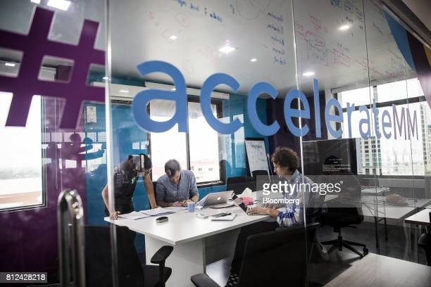 David Madden founder and chief executive officer at Phandeeyar right works with colleagues inside a meeting room at the company's offices in Yangon...