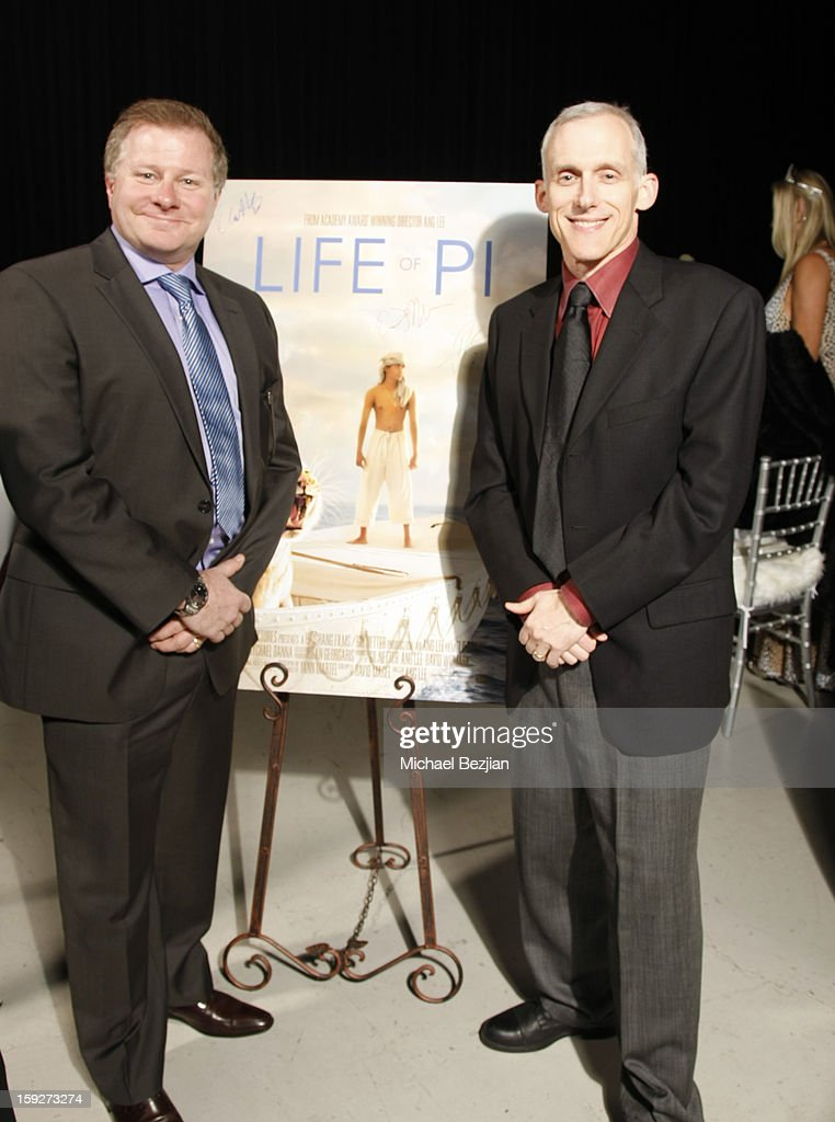 David Magee and Tim Squyres attend the poster signing event for charity during the Critics' Choice Movie Awards 2013 at Barkar Hangar on January 10, 2013 in Santa Monica, California.