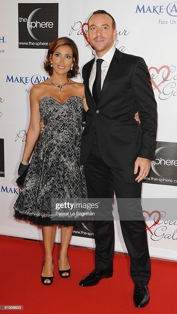 David Manoukian and wife Chantal pose as they arrive to attend the 'Par Coeur Gala' dinner at the Hotel Meurice on September 21, 2009 in Paris, France.