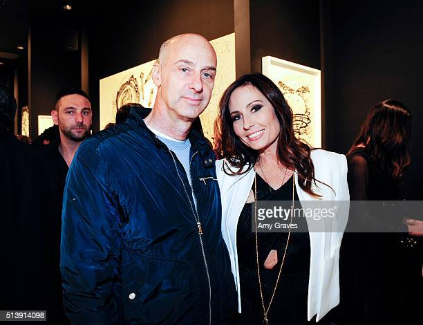David Marciano and Keri Ann Kimball attend the 'Tom Everhart 'Raw' Exhibition of His Schulzinfluenced Paintings For The First Time In Black And White...