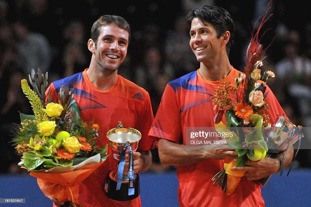David Marrero (L) and Fernando Verdasco (R) of Spain celebrate on September 22, 2013 with their trophy after defeating Britain's Dominic Inglot and Denis Istomin of Uzbekistan in the finale of the St. Petersburg Open tennis tournament in St. Petersburg.