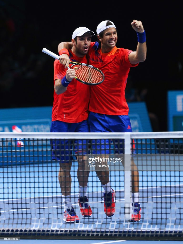 David Marrero (L) and <a gi-track='captionPersonalityLinkClicked' href=/galleries/search?phrase=Fernando+Verdasco&family=editorial&specificpeople=213930 ng-click='$event.stopPropagation()'>Fernando Verdasco</a> of Spain celebrate victory in their men's doubles match against Leander Paes of India and Radek Stepanek of the Czech Republic during day three of the Barclays ATP World Tour Finals at O2 Arena on November 6, 2013 in London, England.